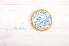 Traditional Dutch birth celebration biscuit with blue muisjes Royalty Free Stock Images
