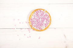Traditional Dutch birth celebration biscuit with pink muisjes Royalty Free Stock Image