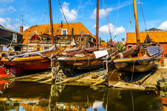 Traditional Dutch Botter Fishing Boats on the Dry Dock in the Harbor of the historic village of Spakenburg-Bunschoten Stock Photography