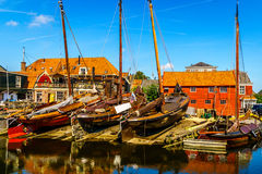 Traditional Dutch Botter Fishing Boats on the Dry Dock in the Harbor of the historic village of Spakenburg-Bunschoten Royalty Free Stock Photography