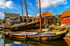 Traditional Dutch Botter Fishing Boats on the Dry Dock in the Harbor of the historic village of Spakenburg-Bunschoten Stock Image