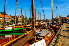Traditional Dutch Botter Fishing Boats in the Harbor of the historic village of Spakenburg-Bunschoten Stock Photos