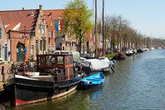 Traditional Dutch Botter Fishing Boats in the small Harbor of the Historic Fishing Village in Netherlands. Traditional Dutch Botter Fishing Boats in the small Stock Photography