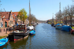 Traditional Dutch Botter Fishing Boats in the small Harbor of the Historic Fishing Village in Netherlands. Traditional Dutch Botter Fishing Boats in the small Stock Photo