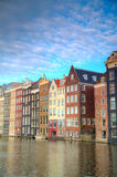 Traditional dutch buildings . canal in Amsterdam Royalty Free Stock Image