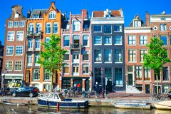 Traditional dutch buildings on canal in Amsterdam Royalty Free Stock Photos