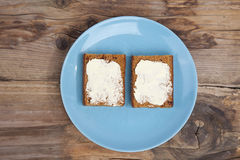 Traditional Dutch cake Ontbijtkoek with traditional butter Stock Photos