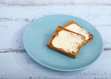 Traditional Dutch cake Ontbijtkoek with traditional butter Royalty Free Stock Image