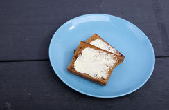Traditional Dutch cake Ontbijtkoek with traditional butter Stock Image