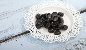 Traditional Dutch candy drop on little plate Stock Photos