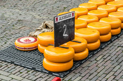 Traditional Dutch cheese market in Alkmaar, the Netherlands. ALKMAAR, THE NETHERLANDS - APRIL 22, 2016: Typical cheese market at the Waagplein in the city of royalty free stock photo