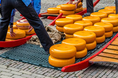 Traditional Dutch cheese market in Alkmaar, the Netherlands. ALKMAAR, THE NETHERLANDS - APRIL 22, 2016: Typical cheese market at the Waagplein in the city of royalty free stock photos
