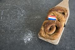 Traditional Dutch cinnamon roll called `Bolus`, on wooden cutting board. royalty free stock photography