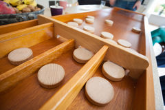 A traditional Dutch game called `sjoelen`. The wooden disks hove Royalty Free Stock Photo