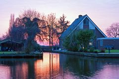 Traditional dutch house in the countryside from Netherlands. Traditional dutch house in the countryside from the Netherlands at sunset Royalty Free Stock Photos