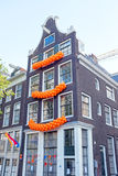 Traditional dutch house decorated on Kings day in Amsterdam the Stock Image