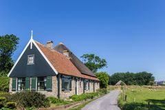 Traditional dutch house in the landscape of Texel island. The Netherlands royalty free stock photos