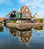Traditional Dutch house mirrored in the water royalty free stock photography