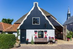 Traditional dutch house in Oudeschild. On Texel island, Holland royalty free stock photos