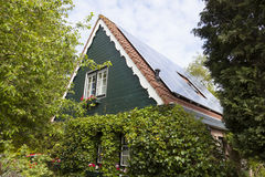 Traditional dutch house with wooden front and solar panels Stock Images