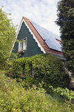 Traditional dutch house with wooden front and solar panels Royalty Free Stock Images
