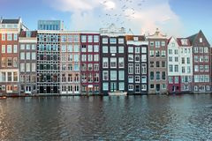 Traditional dutch houses along the canals in Amsterdam Netherlands. Europe stock images