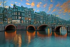 Traditional dutch houses in Amsterdam the Netherlands. At sunset Royalty Free Stock Images