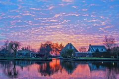 Traditional dutch houses in the countryside from Netherlands. Traditional dutch houses in the countryside from the Netherlands at sunset Stock Photography