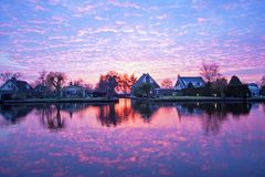 Traditional dutch houses in the countryside from the Netherlands. At sunset Stock Photos