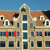 Traditional dutch medieval building in Amsterdam, Netherlands Stock Photos