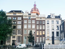 Traditional dutch medieval buildings in Amsterdam, Netherlands. Stock Image