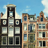 Traditional dutch medieval buildings in Amsterdam, Netherlands Royalty Free Stock Images