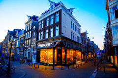 Traditional dutch medieval houses in Amsterdam at evening, Netherlands Royalty Free Stock Photos