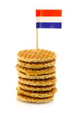 Traditional Dutch mini waffles with flag toothpick. Traditional Dutch mini waffles called stroopwafels with a Dutch flag toothpick on a white background stock photo