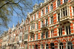 Free Traditional Dutch Old Facades Located On Weesperzijde Street Along Amstel River, Amsterdam Royalty Free Stock Images - 148806569