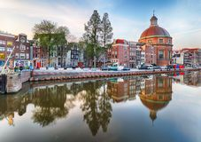 Traditional Dutch old houses on canals in Amsterdam Royalty Free Stock Images
