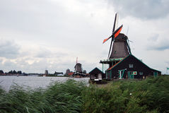 Traditional Dutch old wooden windmill in Zaanse Schans - museum Royalty Free Stock Photo