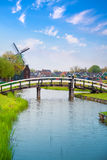 Traditional Dutch old wooden windmill in Zaanse Schans stock photo