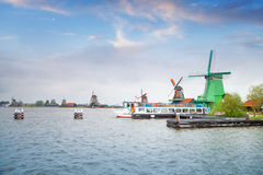 Traditional Dutch old wooden windmill in Zaanse Schans stock images