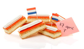 Traditional Dutch pastry called tompouce with flags Stock Photo