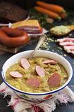 Traditional Dutch pea soup and ingredients on a rustic table Stock Image