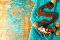 Traditional Dutch Saint Nicolas celebration with presents for ch. Ildren in December, Saint Nicolas chocolate letters and spicy cookies close up Royalty Free Stock Photography