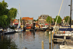 The traditional Dutch village of Enkhuizen. Old harbour of Enkhuizen, traditional Dutch village in the north Holldn province, The Netherlands. Saling boats stock image