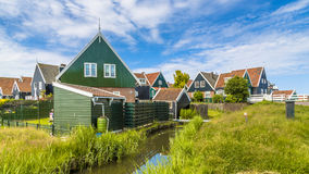Traditional Dutch village scene with wooden houses and canal Royalty Free Stock Photos