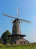 Traditional dutch windmill. Traditional windmill in Netherlands with blue sky Stock Images