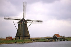 Traditional Dutch Windmill. A traditional Dutch windmill at the UNESCO site, Kinderdijk-Elshout in the Netherlands royalty free stock photo