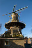 Traditional dutch windmill in the city of Delft Stock Photography