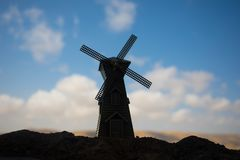 Traditional, Dutch windmill at a hill during a summer sunset. Decoration. Selective focus stock images