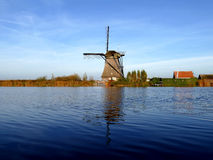 Traditional dutch windmill near the canal Stock Photography