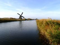Traditional dutch windmill near the canal Stock Image